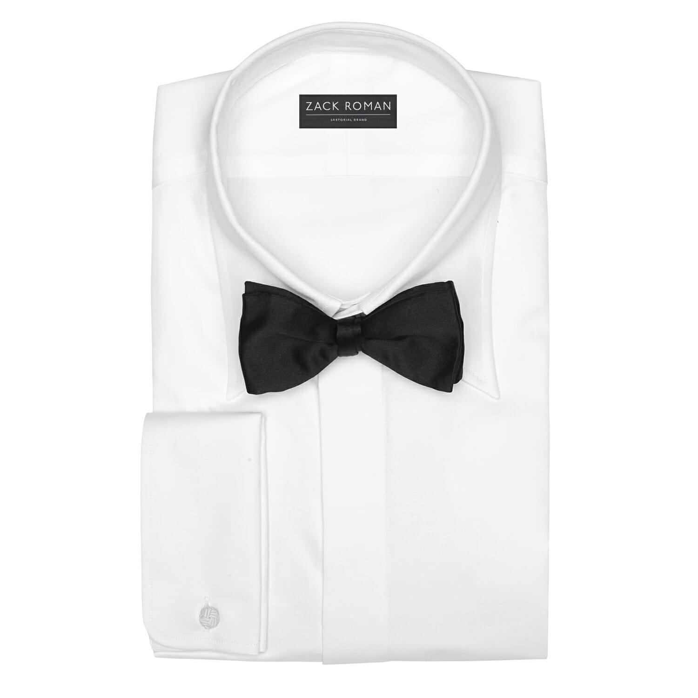 biała koszula i czarna mucha