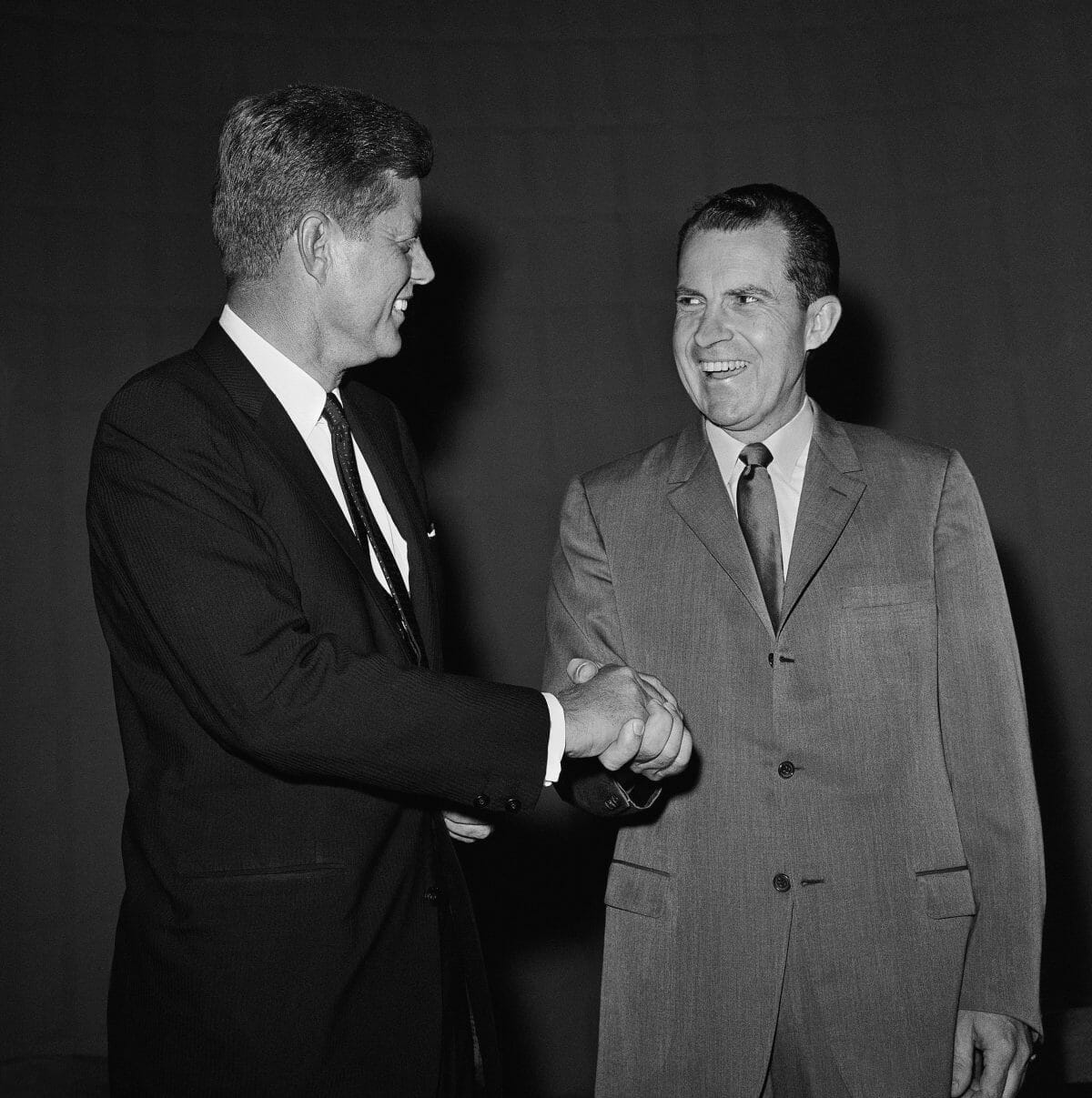 Presidential nominee Richard Nixon and Sen. John F. Kennedy shake hands, Sept. 26, 1960 in Chicago, as they hired television studio to take part in their debate. (AP Photo)